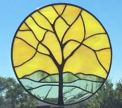 stained glass yellow sky circle tree