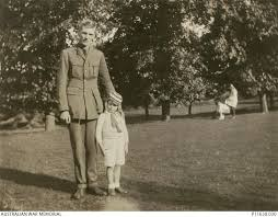 Informal portrait of an unidentified soldier and a young girl ...