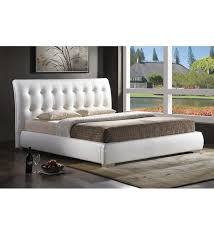 jeslyn white faux leather platform bed
