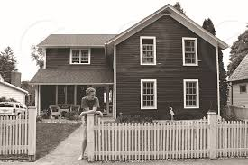 Gray And White Cape Cod House With White Picket Fence And Boy Leaning On Fence Post By Carly Tobias Photo Stock Snapwire