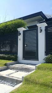 Modern Minimalist Facade With Clean Lines And Dark Gray White And Green House Gate Design House Fence Design Modern Fence Design