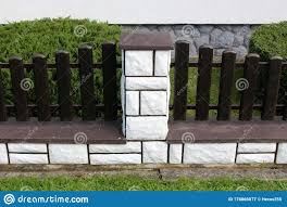Side View Of Brown Wooden Picket Fence Mounted On Concrete Foundation Covered With White Stone Tiles In Front Of Suburban Family Stock Image Image Of Fence Tiles 176866077