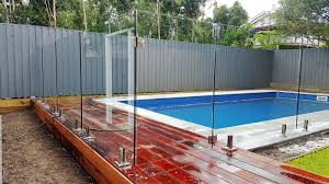 Glass Pool Fencing On Timber Decking Robina Insular Patios Fencing