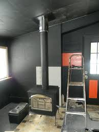 black stove pipe chimney pipe and wood