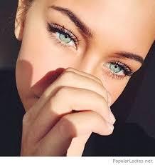 vrey beautiful blue eyes and natural makeup