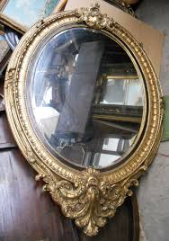 huge gilt mirror oval shaped hanging