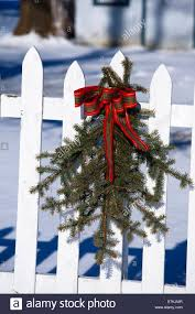 Christmas Outdoor Decoration Pine And Red Ribbon On White Picket Stock Photo Alamy
