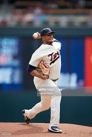 Adalberto Mejia of the Minnesota Twins delivers a pitch against ...