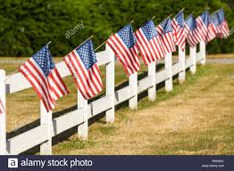 Patriotic Display Of American Flags Waving On White Picket Fence Typical Small Town Americana Fourth Of July Independence Day Decorations Stock Photo Alamy