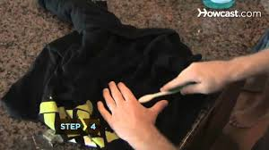 how to get oil sns out of clothing
