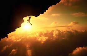 man climbing mounn with cloudy skies