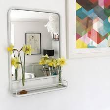 white framed carriage mirror with shelf