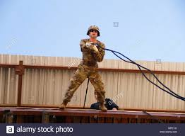 U.S. Army Capt. Brad Barron leans off the tower to rappel Aussie style  during the Rappel