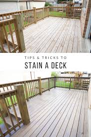 How To Stain Your Deck Quickly With A Paint Sprayer The Diy Playbook