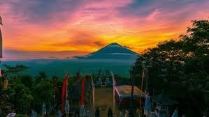 sunset on the background volcano gunung agung in bali