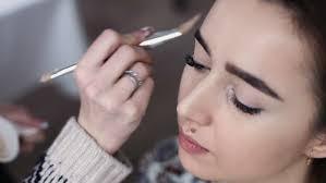 a cute model gets makeup stock fooe