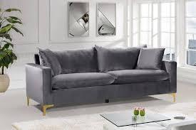 grey velvet gold chrome legs sofa