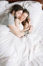 couple sleeping hugging on pillow by