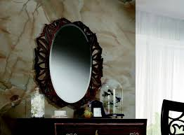 the round mirror in a carved frame in