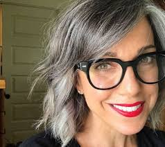 sporting natural gray hair