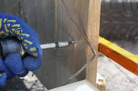A Carpenter Working With An Electric Screwdriver Repairing A Wooden Fence In Protective Gloves Stock Image Image Of Joinery Industrial 145029111