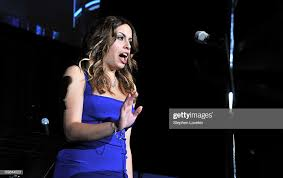 Singer Adriana Lee sings the National Anthem onstage at the 2011... News  Photo - Getty Images