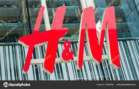 h m logo on a stock editorial