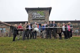 olive garden cuts ribbon on college
