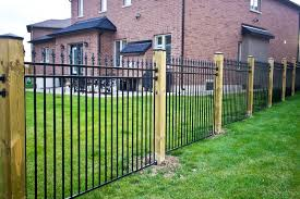 Spike Topped Metal Fence With Wood Posts Metal Fence Modern Fence Fence Design