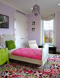 Bright Floral Rug With Contemporary Kids Also Bold Chandelier Dark Stained Wood Floor Floral Print Area Rug High Ceilings Hot Pink Lilac Lime Green Nightstand Lounge Chair Ring Pulls Roman Shade Upholstered