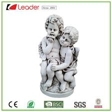angel sitting boy and girl statue