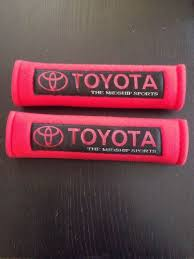 toyota shoulder pads in red seat belt