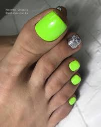 Neon green and silver accent nail pedicure idea (With images ...