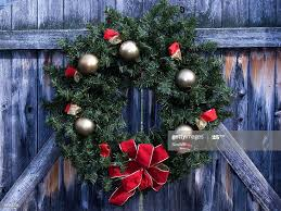 Christmas Wreath On Rustic Wooden Fence High Res Stock Photo Getty Images