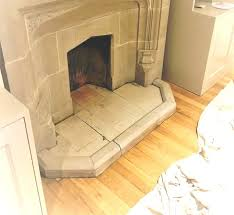 old grubby stone fireplace transformed