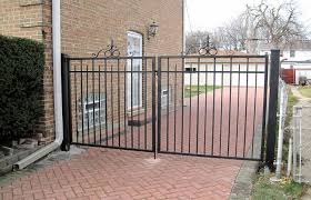 A Custom Driveway Wrought Iron Double Gate Fencing System Fabrication And Installation Wrought Iron Driveway Gates Wrought Iron Gates Iron Fence Gate