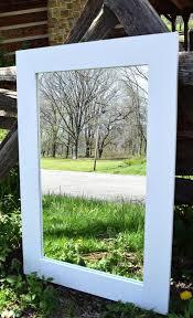 modern white framed mirror bathroom