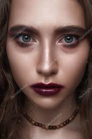 rocker beauty with dark red makeup