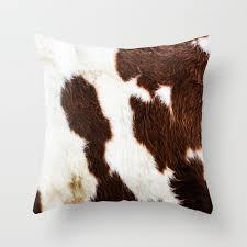 cowhide brown spots throw pillow by