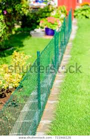 Green Mesh Garden Fence Dividing Two Parks Outdoor Stock Image 711944128