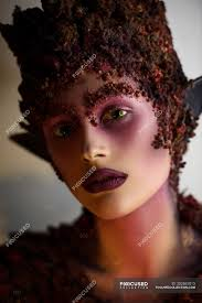 young woman with fantasy makeup art