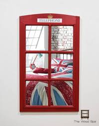 old window mirror phone booth wall