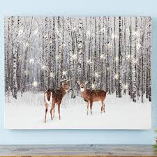 lighted deer in forest canvas wall art