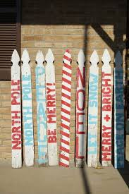 The Stockings Were Hung On The Picket Signs With Care Picket Fence Crafts Christmas Signs Christmas Diy