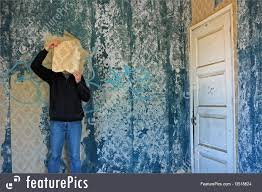 surreal art man with torn wallpaper