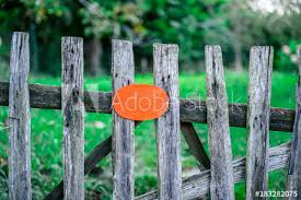 Rustic Wooden Fence Holding A Blank Orange Board Buy This Stock Photo And Explore Similar Images At Adobe Stock Adobe Stock