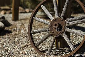 Wagon Wheel On Fence Buy This Stock Photo And Explore Similar Images At Adobe Stock Adobe Stock