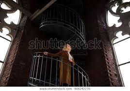 spiral staircase near stainedglass