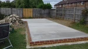 concrete base with brick surround