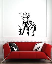The Decal Store Com By Yadda Yadda Design Co Wall Banksy Style Girl Frisking Soldier Wall Or Door Vinyl Decal